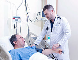 Patient being treated by a cardiologist