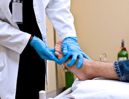 Physician treating a patient