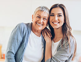 Portrait of mother and daughter embracing for a photo